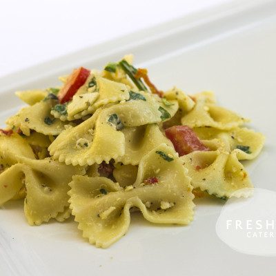 side of bowtie pasta with provolone cheese, spinach and tomatoes