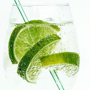 Clear glass with limeade and a straw