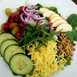 Green Salad with vegetables, fruit and cheese