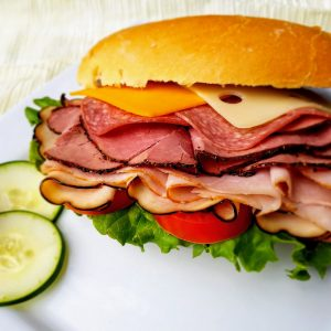 "sandwich on 6"" white roll filled with turkey, ham, roast beef, salami, lettuce, tomato, cheddar cheese and swiss cheese"