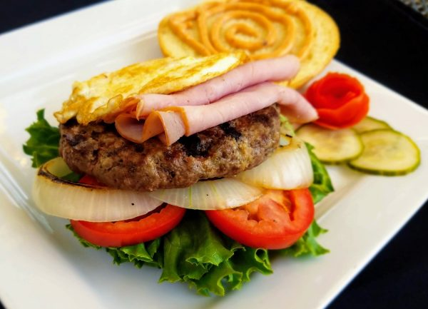 Beef burger with ham and fried egg