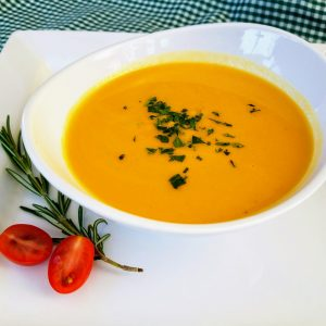 bowl of butternut squash soup with parsley garnish