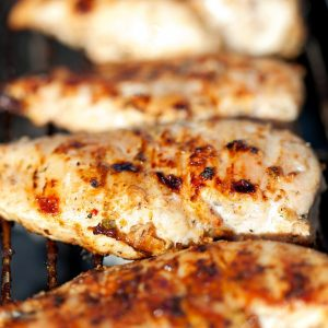 chicken breast cooking on the grill