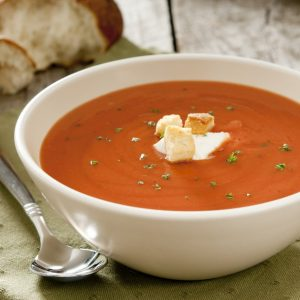 bowl of cream of tomato soup with crouton garnish